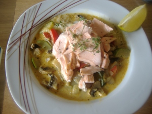 Spices coconut and noodle soup with lime infused salmon