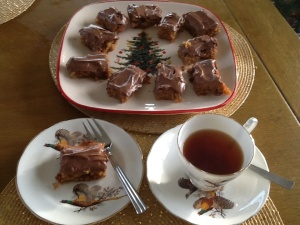 Cranberry and Date tray bake with chocolate and orange cream cheese frosting